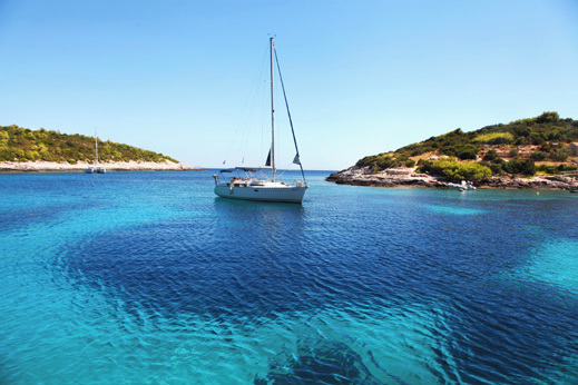 Hidden bays and coves at Vis island. Sailing Dalmatian Islands.