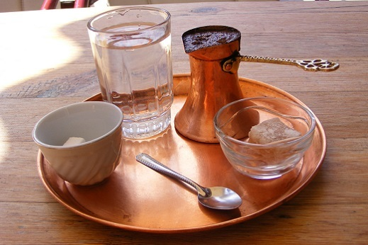 "Try the ""Turkish"" coffee, traditional way of serving coffer in Montenegro."