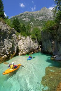 Kayaking on turquoise Soca river