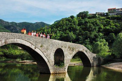 Biking Montenegro, the old bridge or Crnojevica river