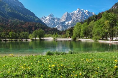 Clear waters of Jasna Lake under Julian Alps.