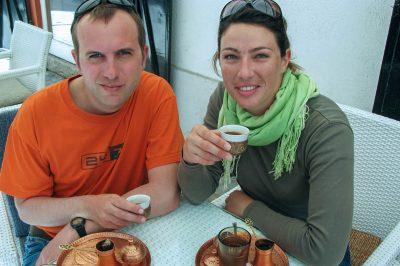 Drinking Balkans' traditional Turkish coffee from 'Dzezva'